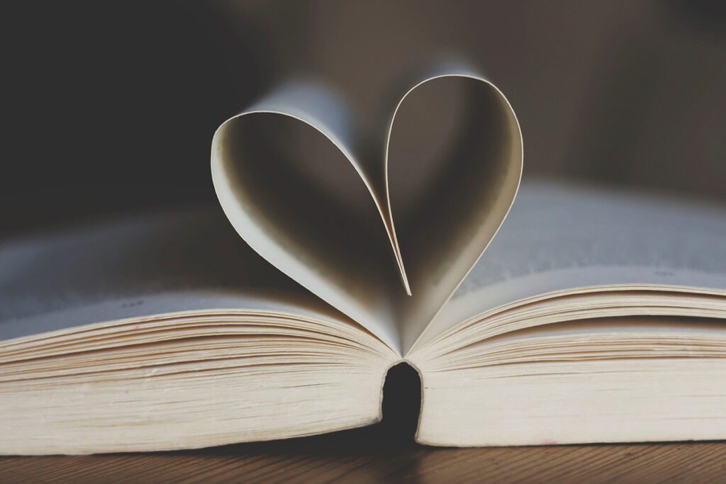 Open book with pages in middle folded into the shape of a heart
