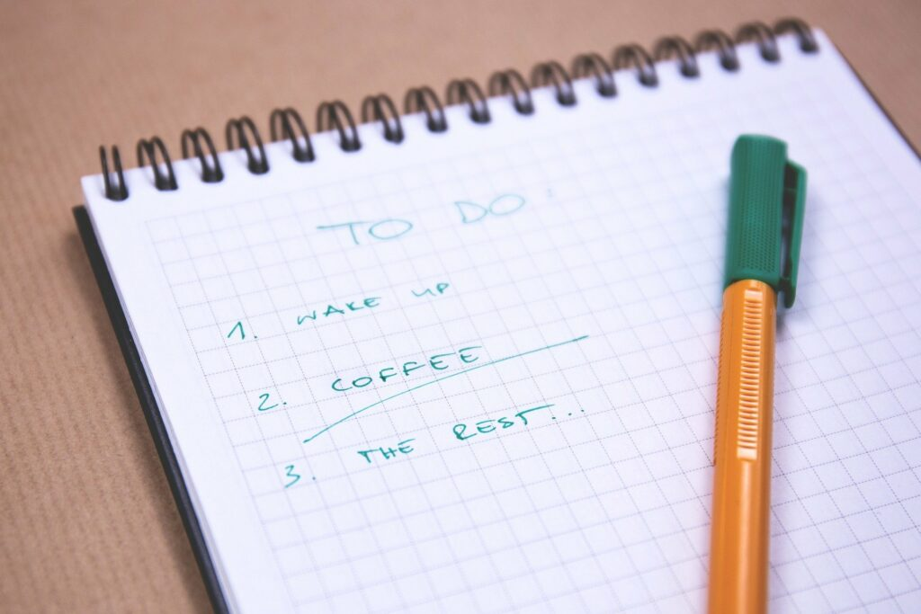 Daily task checklist on paper with pen