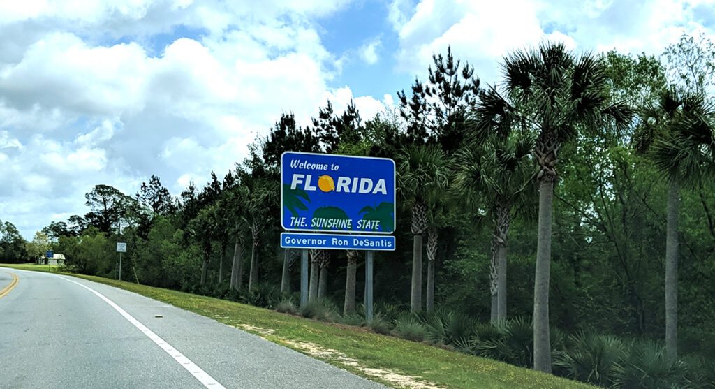 Sign along the highway stating welcome to Florida