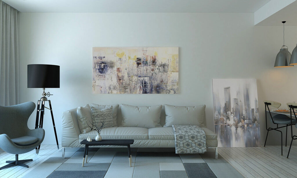 A modern living room with couch, coffee table, and wall paintings