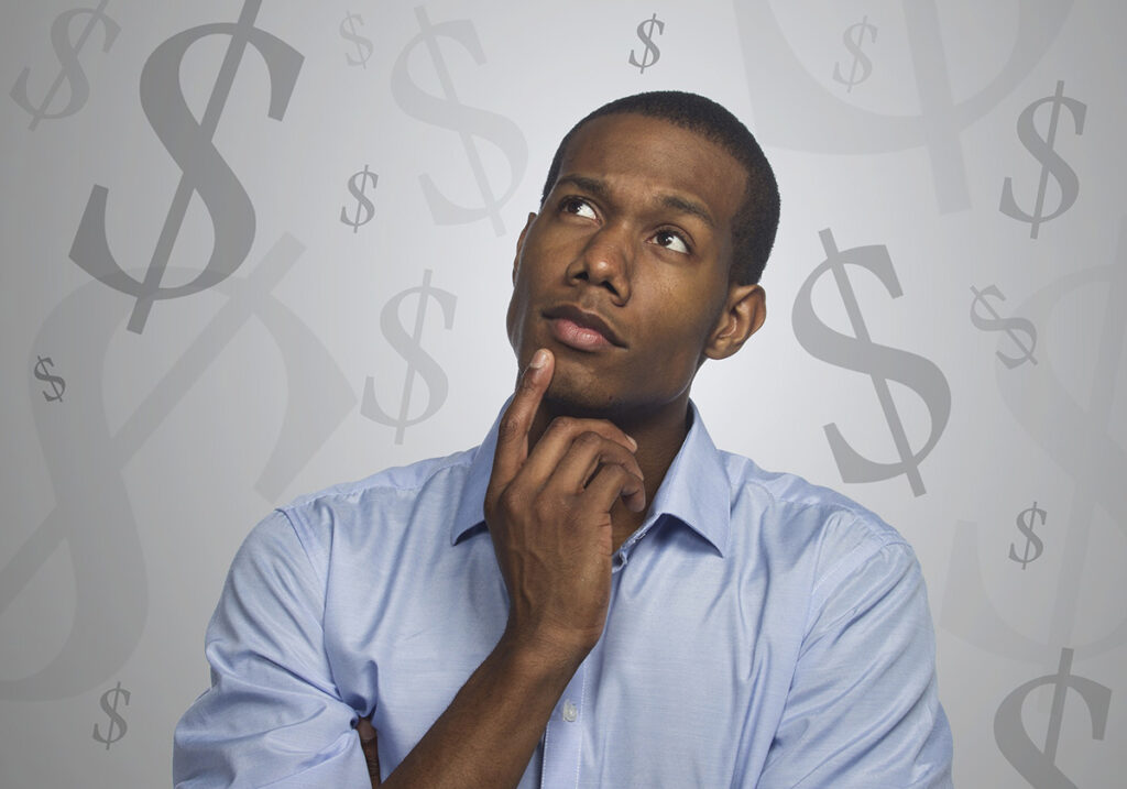 Man stands with a thoughtful expression surrounded by graphical dollar signs